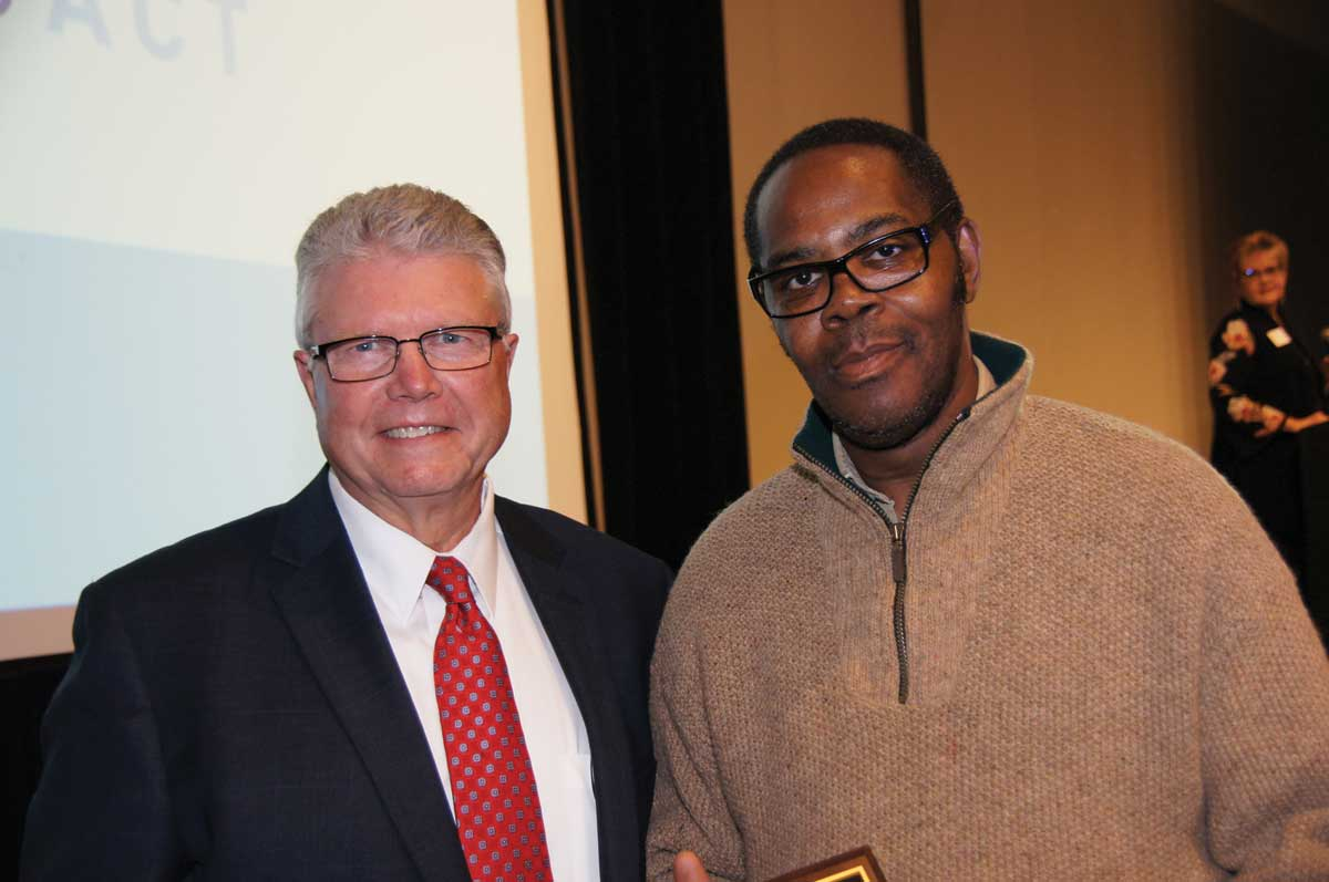 "ProAct CEO Steven Ditschler presented the ""Elmer Bester Award"" to George Thomas."