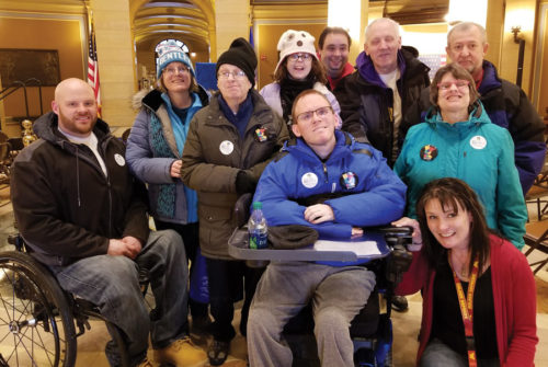 Direct service professional Mike Hurley, left and classroom instructor Angi Fleury, lower right, brought ProAct ADS participants to Disability Services Day at the Capitol in March. The large rally focused on improving wages for staff members.