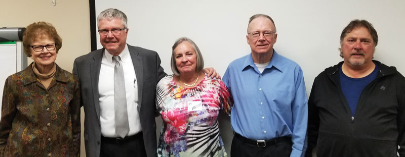 Flanked by ProAct veteran retirees Carolyn Dobis and Dave Cavalier, Pat McGuire, second from right, was wished well by staff at a breakfast event. At left are Director Sally Ogren and President Steven Ditschler.