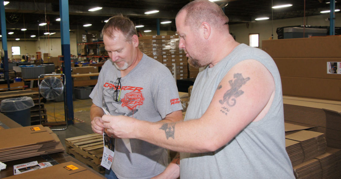 Matt Weisz, right, and HST Dave Runge work the mat cutting table in Red Wing.